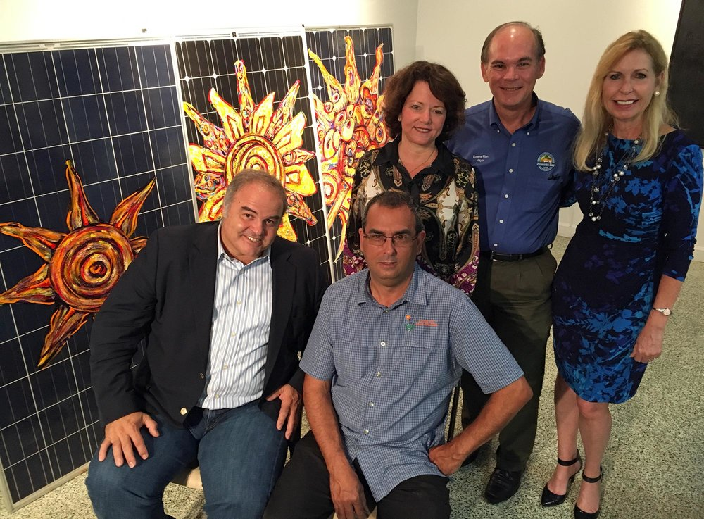 [L to R] Artist Xavier Cortada, Raul Vergara (owner, Cutler Bay Solar Solutions), Pinecrest Mayor Cindy Lerner,