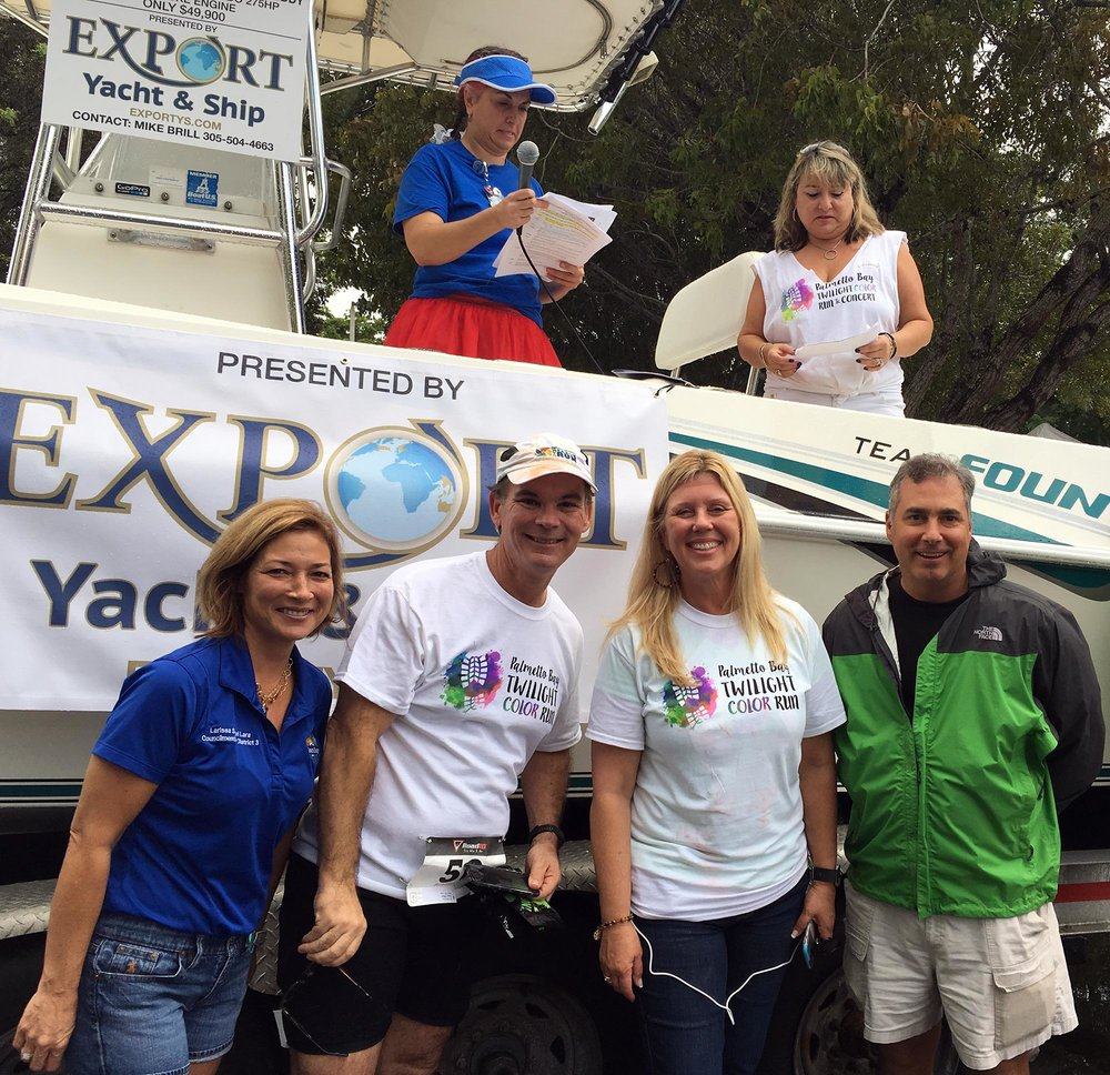 [L to R] Palmetto Bay's Councilwoman Larissa Siegel Lara, Mayor Eugene Flinn, Councilwoman Karyn Cunningham and Pinecrest's Mayor-elect Joe Corradino join Miami Palmetto Senior High School's PTA President Dina Lara (above, right) at Color Run