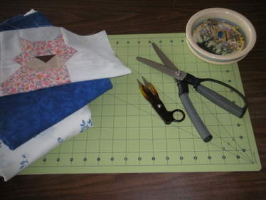 BASIC QUILTING SUPPLIES INCLUDE GOOD SCISSORS AND THREAD SNIPS.