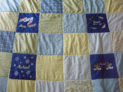 FINISHED QUILT WITH CUSTOM EMBROIDERED BLOCKS ADDED TO PERSONALIZE