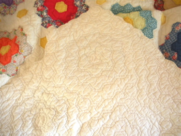 BACK OF HAND QUILTED QUILT