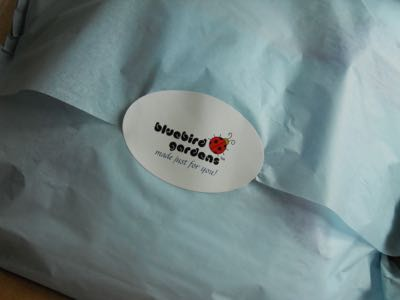 shipping item with bluebird garden label