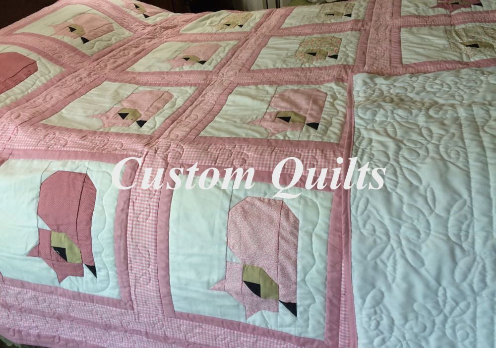 Bluebird Gardens custom pink sleeping cats quilt.