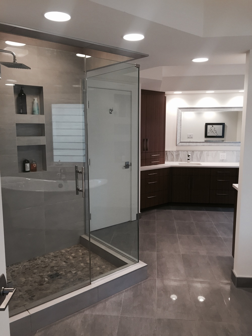 Custom walnut cabinetry, custom shower, master suite.