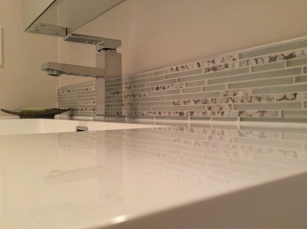 Glass and resin pebble backsplash.