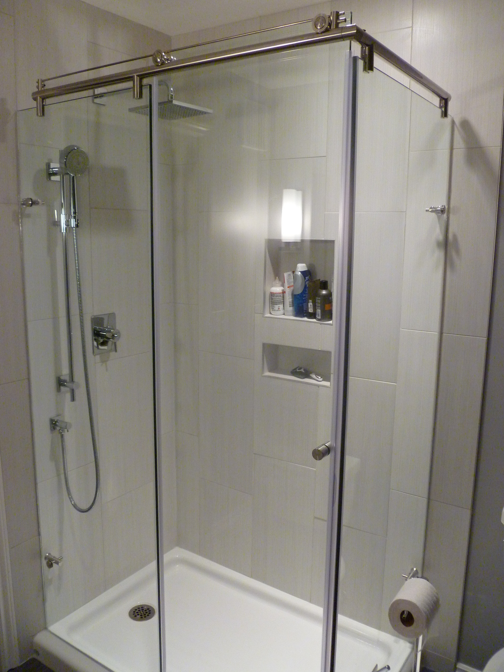 Custom Shower, porcelain shower surround, recessed shower shelves.