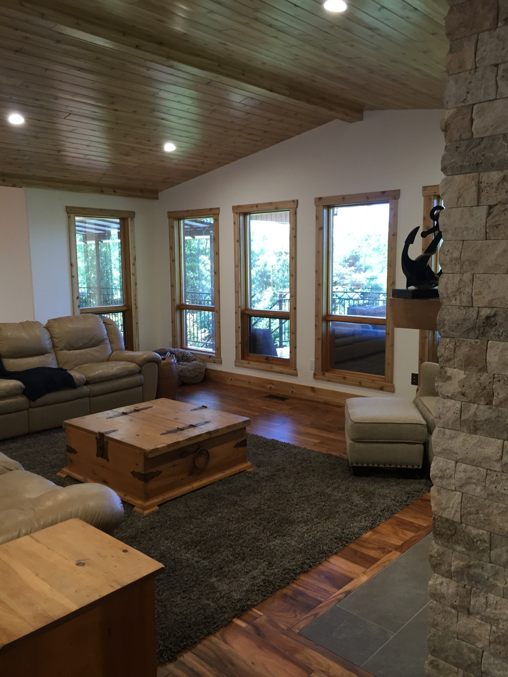 Rustic stone fireplace, cedar ceilings and window trim.