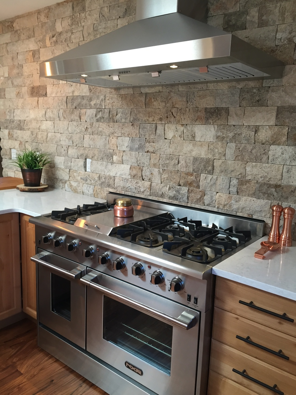 Professional range and hood fan, quartz countertops, rustic stone, Blanchette Slate.