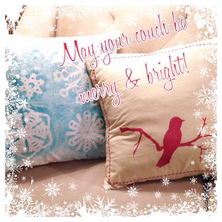 Snowflake reverse-stenciled pillow cover, red bird stenciled pillow cover with decorative stitching.