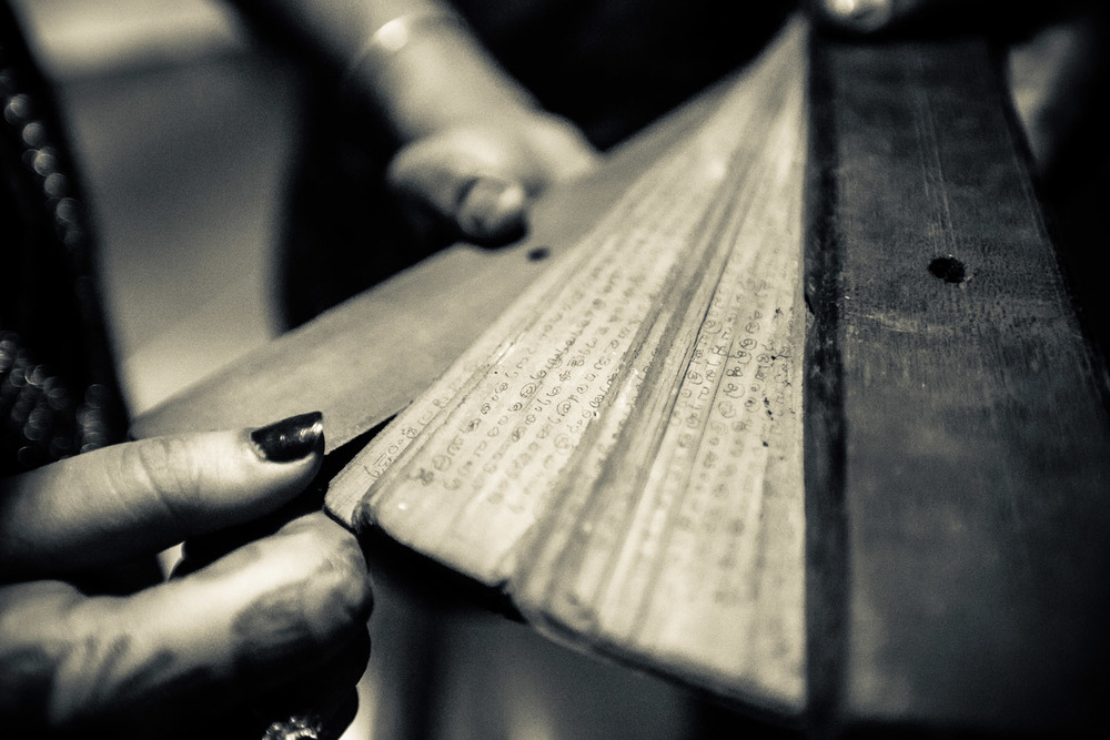 Old Malayalam scriptures on an attic, shot at grooms native place.