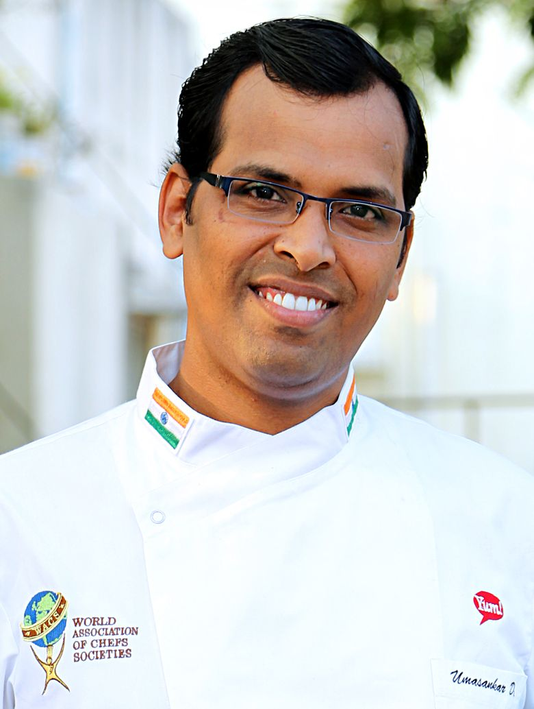 "Umasankar Dhanapal  is a Passionate Culinary Artist, Hospitality & Restaurant Operations Trainer with 15 Years of Experience and numerous International Recognition.  He is featured as a "" Master Chef "" in the book "" 50 Master Chefs of India "" Published by Indian Culinary Forum and Hospitality Biz Magazine, a recipient of "" STAR CHEF "" award from Indian Federation of Culinary Associations (IFCA). He has hosted 1000+ Training Sessions on Hotel, Restaurant and Retail Operations, Culinary Artistry and Service Excellence."