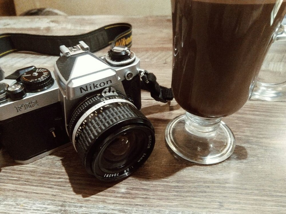 Nikon FE2 with 24 mm f/2.8 AIS Manual Lens along with Mint Hot Chocolate ;) Shot on my mobile phone.