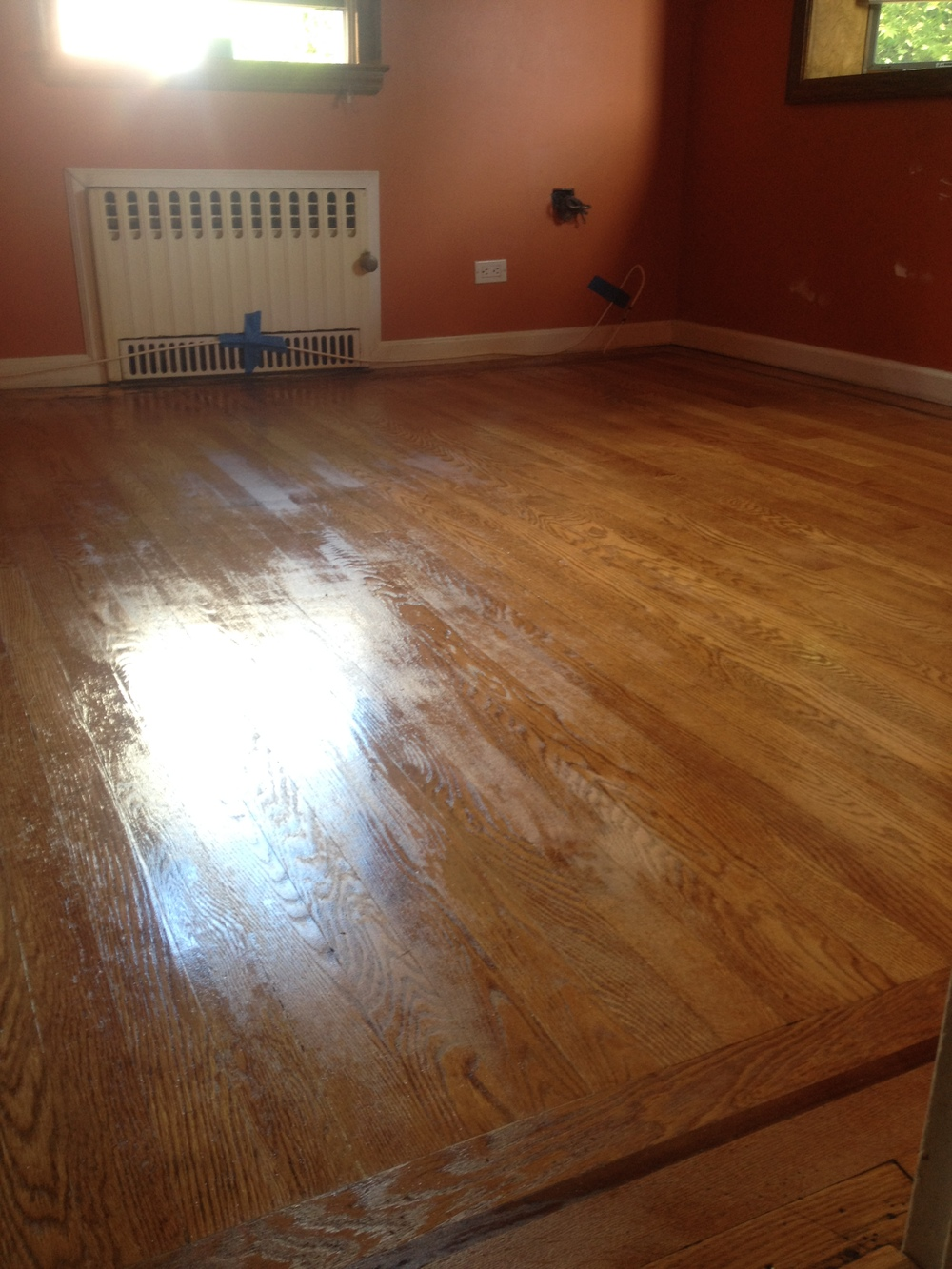 The wooden floor with the stain and sealant