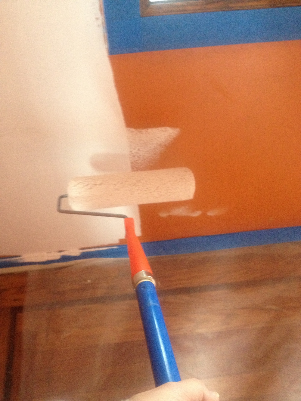 Painting over that strong orange paint  (thank goodness for painter's tape)