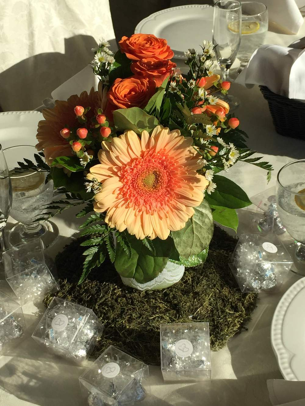 Evelisa Floral & Design's Coral & Mint mason jar Centerpiece.