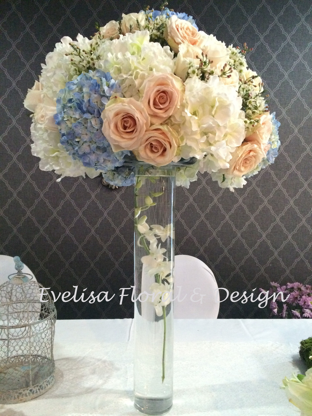 We created this arrangement and it's actually a combination of Faux & Real flowers.