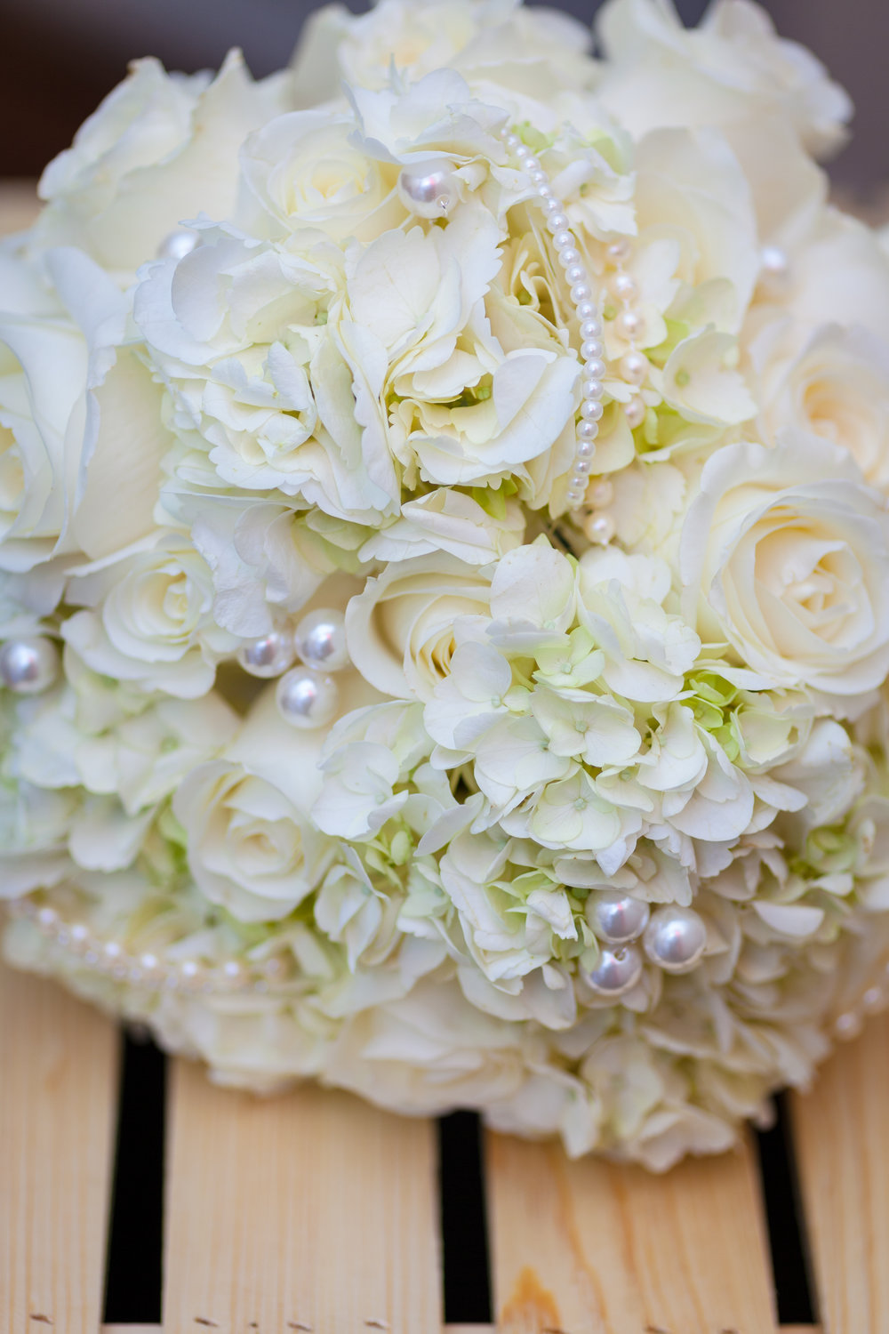 Close up of Bride's White Pearl Bouquet created by Evelisa Floral & Design, photographed by Dpsnapsphotography