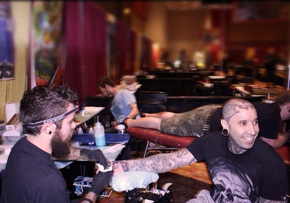 Sean Herman tattooing Yall at Hell City.