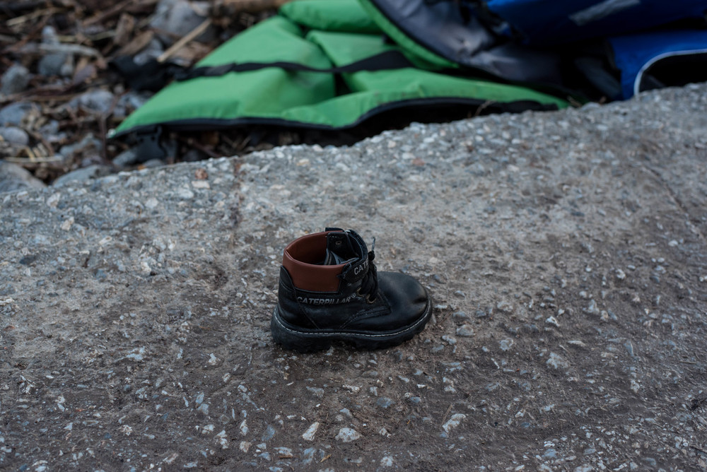 A child's boot left behind. Water-logged shoes are usually the first possessions cast aside.