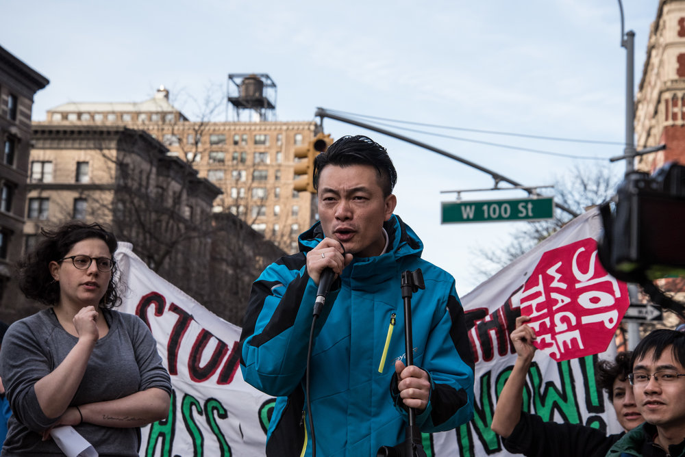 Vincent Cao, a waiter and community organizer working with Chinese Staff and Workers' Association,speaks at a rally in support of the SWEAT Bill.