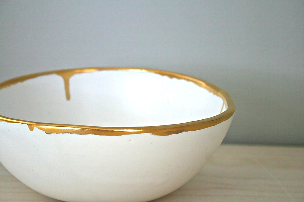Gold rim bowls form The Flow collection.