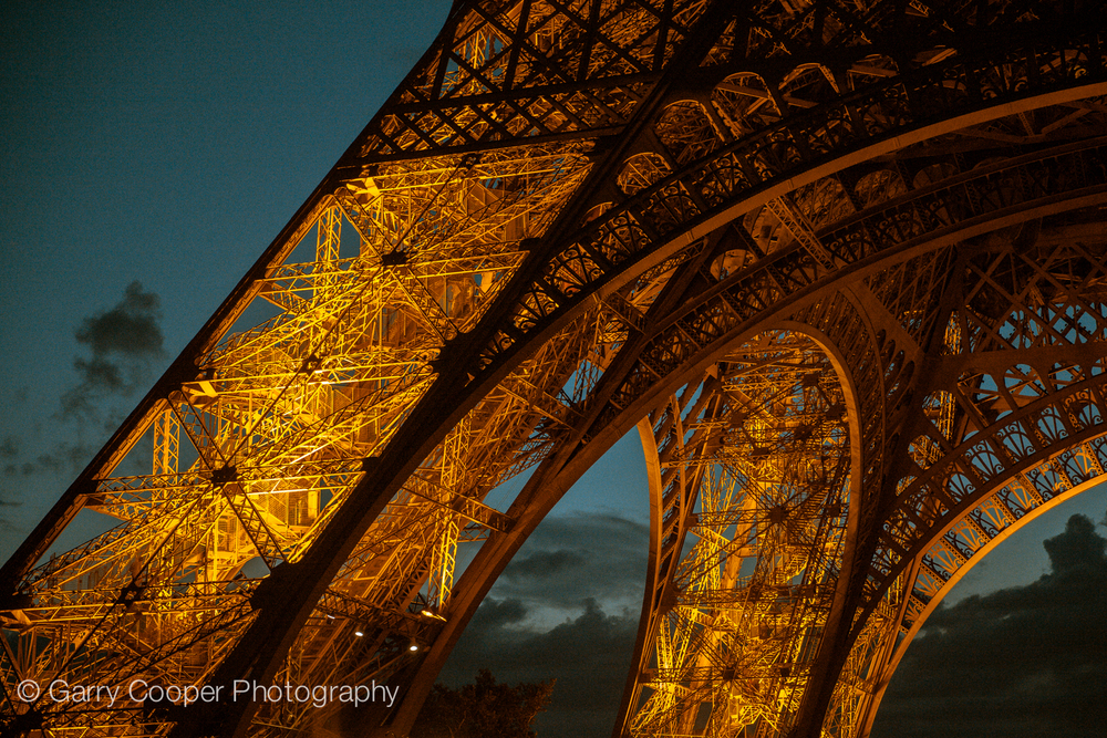 Eiffel Tower pillars at night