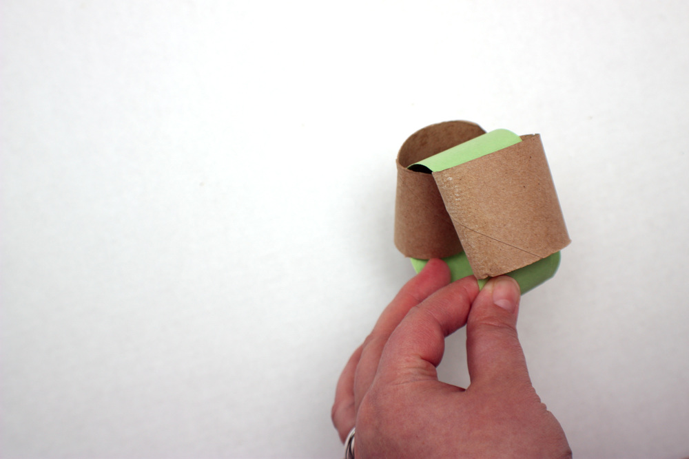 Step 5: Secure the ends together, then slide the roll down to cover the seam.