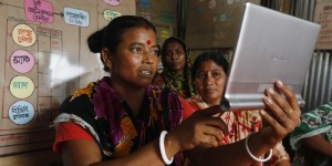 renu bala uses a tablet to contact buyers and keep track of market information. photo: abir abdullah/oxfam