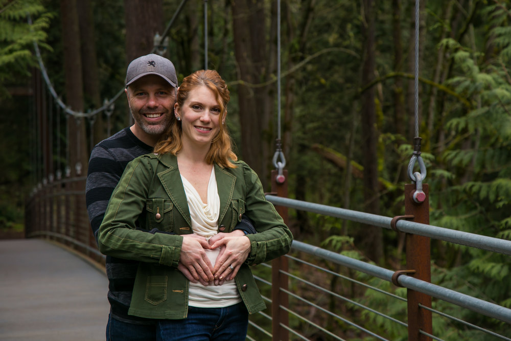Seattle Family Photographer | G. Lin Photography | Couple standing on bridge smiling at camera