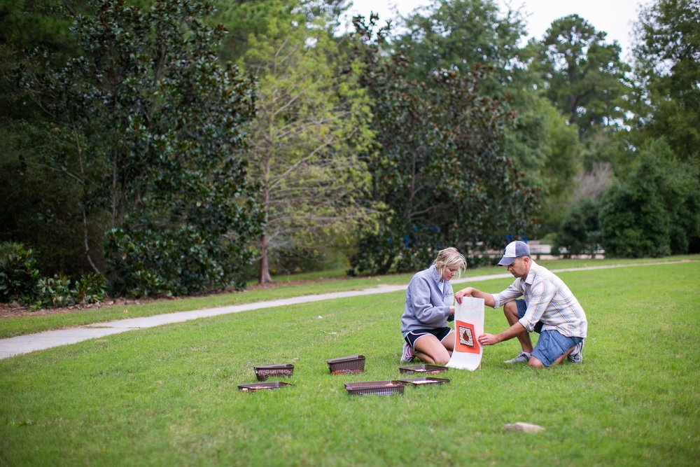 Raleigh Family Photographer | G. Lin Photography | Parents setting up booth on lawn