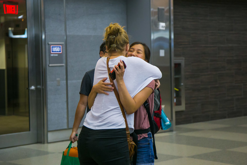 Raleigh Engagement Photographer | G. Lin Photography | Woman hugging friend at airport