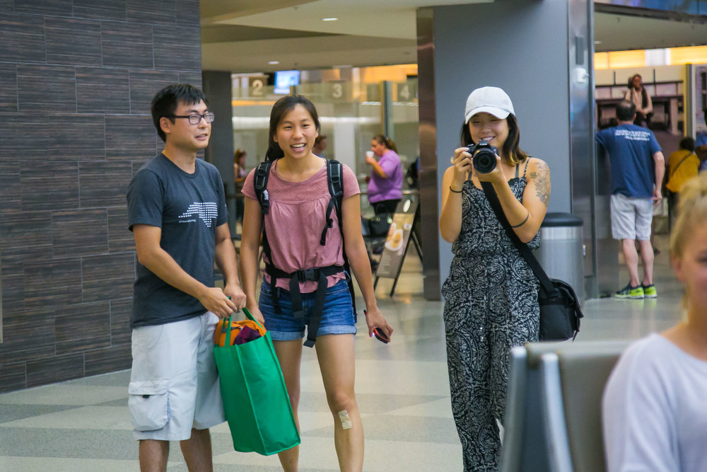 Raleigh Engagement Photographer | G. Lin Photography | People standing at arrivals at airport