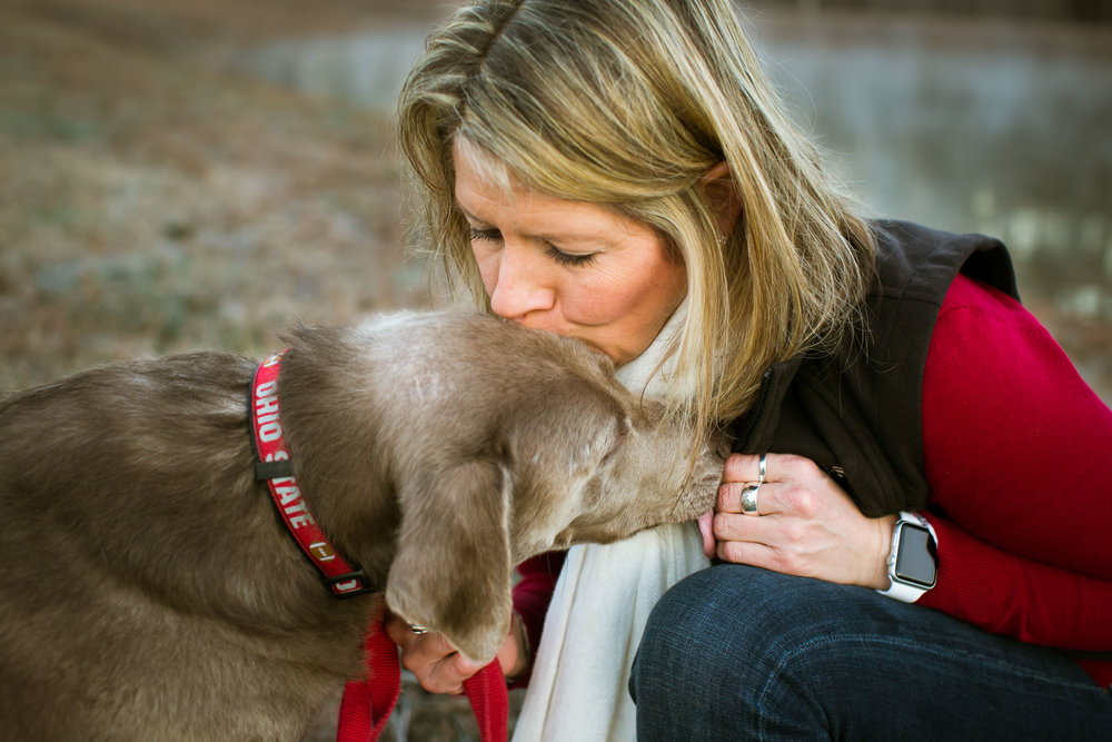 Durham Family Photographer | G. Lin Photography | Woman kissing dog's head