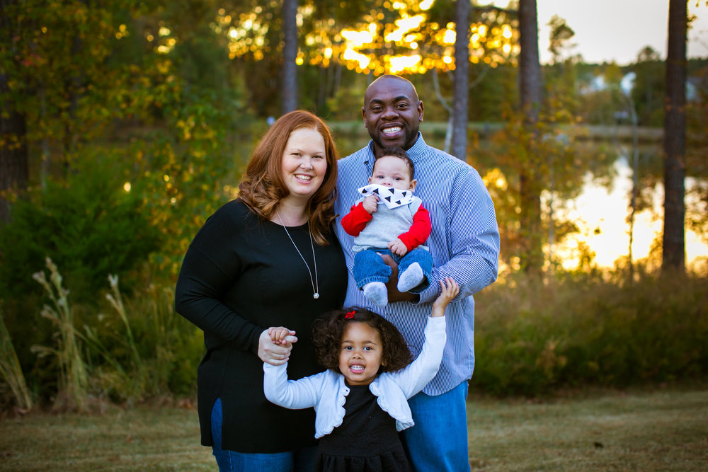 Durham Family Photographer | G. Lin Photography | Family smiling at camera at park