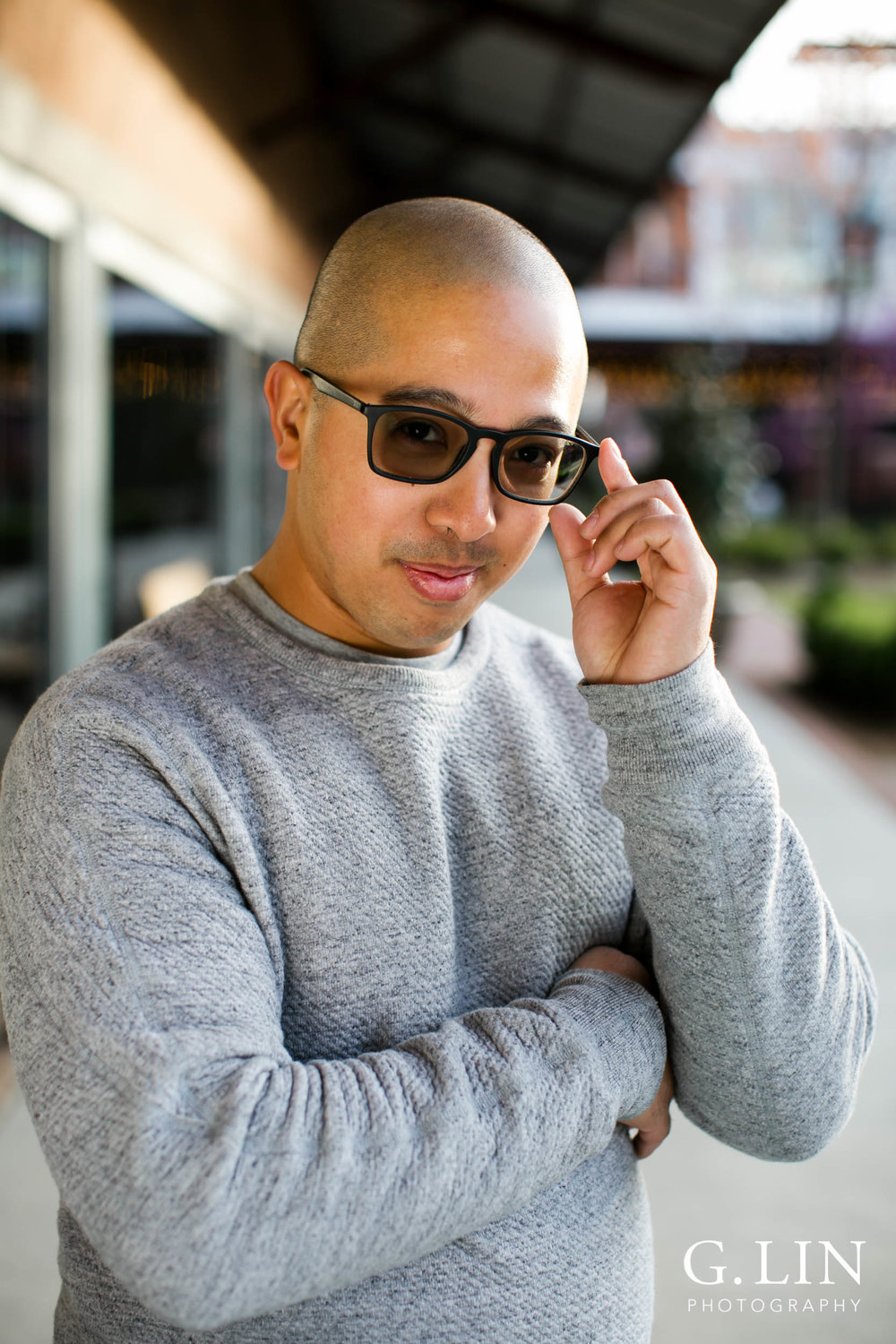 Durham Family Photographer | G. Lin Photography | Man in front of store holding sunglasses