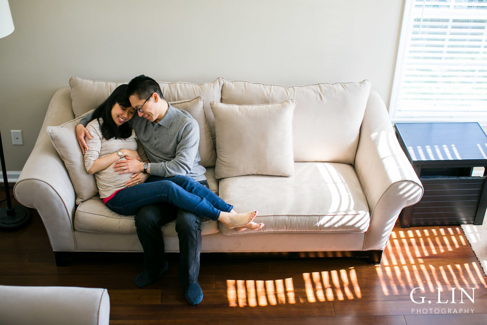 Durham Maternity Photography | G. Lin Photography | Wide shot of couple sitting on couch