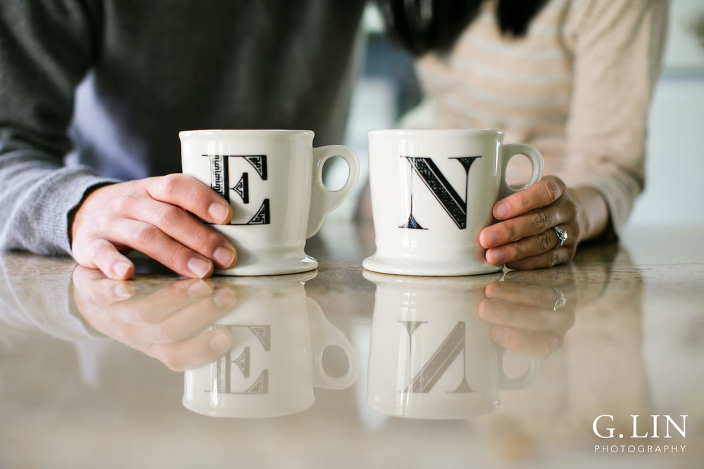 Durham Maternity Photography | G. Lin Photography | Close up shot of couple holding mugs in kitchen