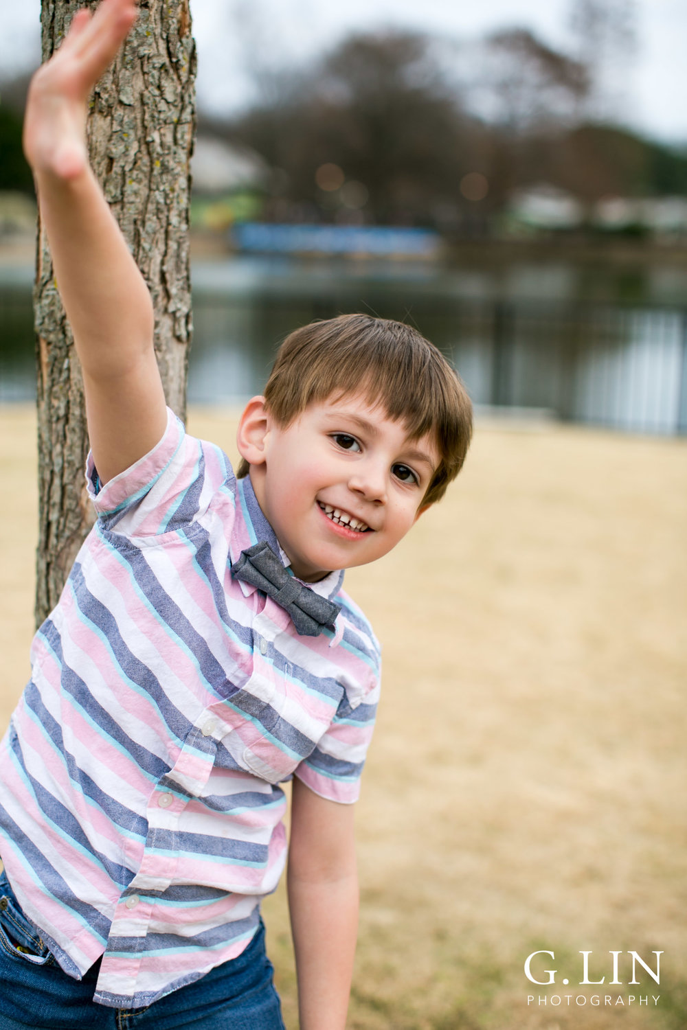 Raleigh Family Photographer | G. Lin Photography | Boy standing next to tree and smiling
