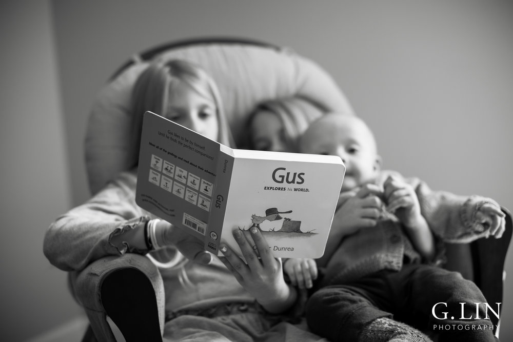 Raleigh Family Photographer | G. Lin Photography | Children sitting on chair and reading to little brother
