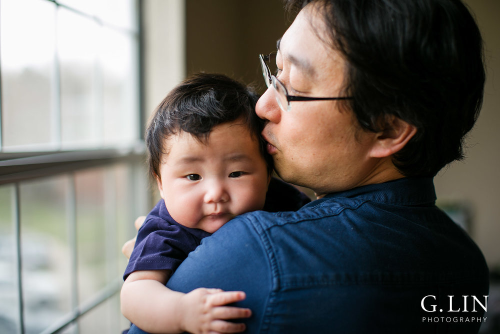 Durham Family Photographer | G. Lin Photography | Dad holding baby at home