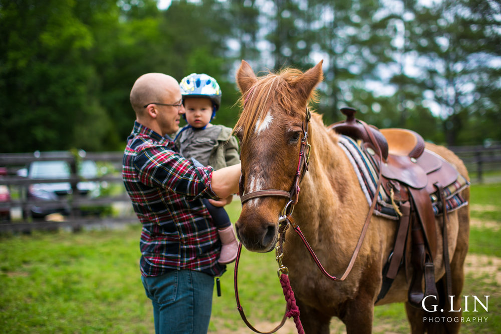 G. Lin Photography | Raleigh Event Photographer | Father and son petting horse on field
