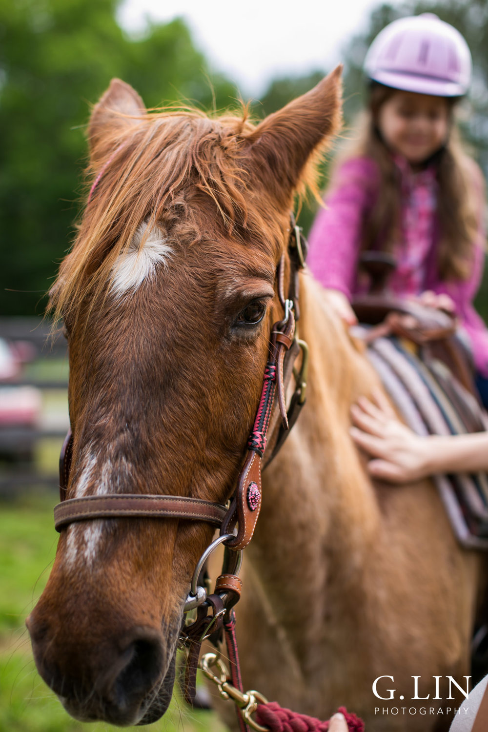 G. Lin Photography | Raleigh Event Photographer | Girl on horse riding around track