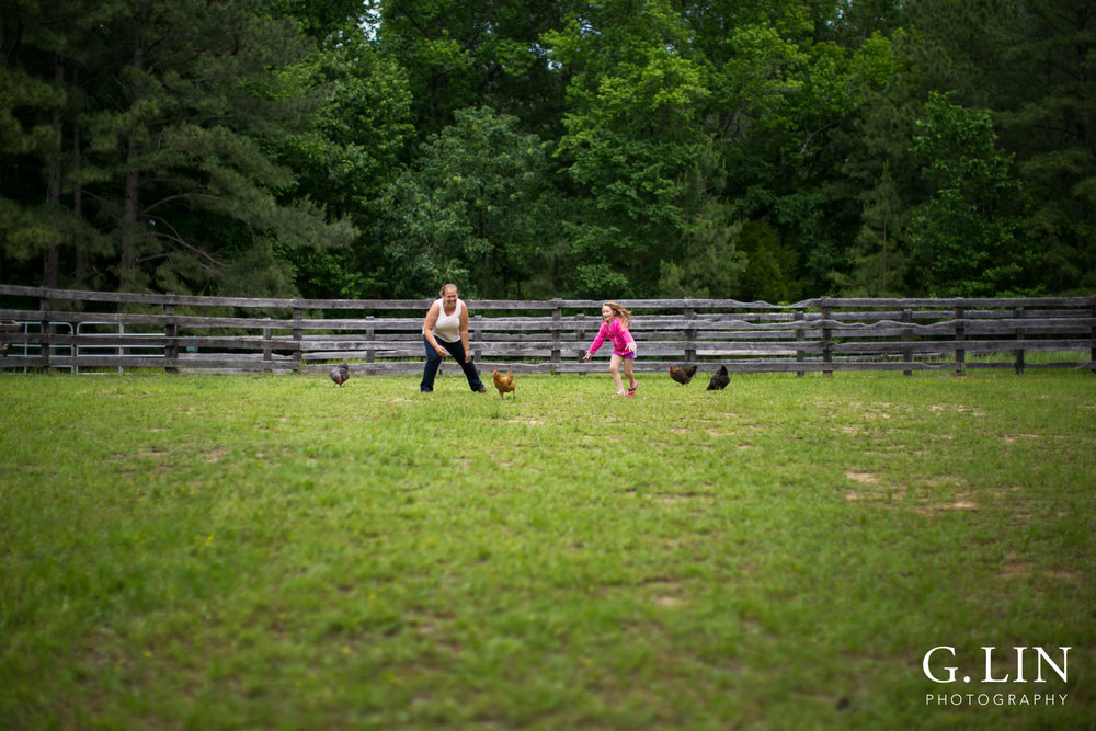 G. Lin Photography | Raleigh Event Photographer | Woman and girl on farm chasing chickens