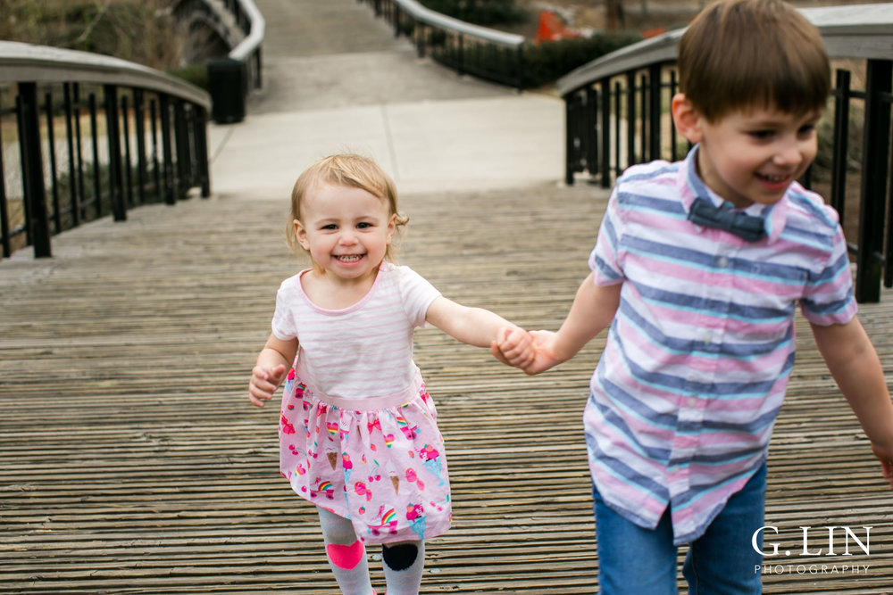 G. Lin Photography | Raleigh Family Photographer | Siblings holding hands and running towards camera