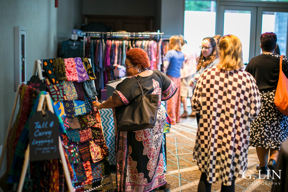 Raleigh Event Photographer | G. Lin Photography | Women browsing at clothing inside hotel