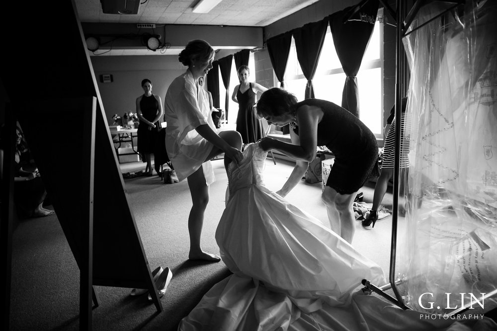 Raleigh Wedding Photographer | G. Lin Photography | Mom helping daughter get into wedding dress | Black and white photo