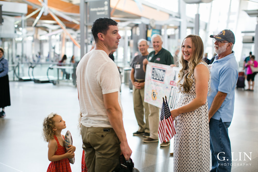 Raleigh Family Photographer | G. Lin Photography | dad greeted by USO and volunteers