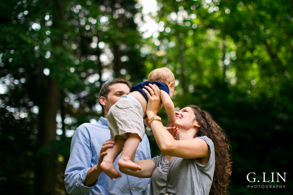Raleigh Family Photography | G. Lin Photography | Mom and dad throwing baby in the air