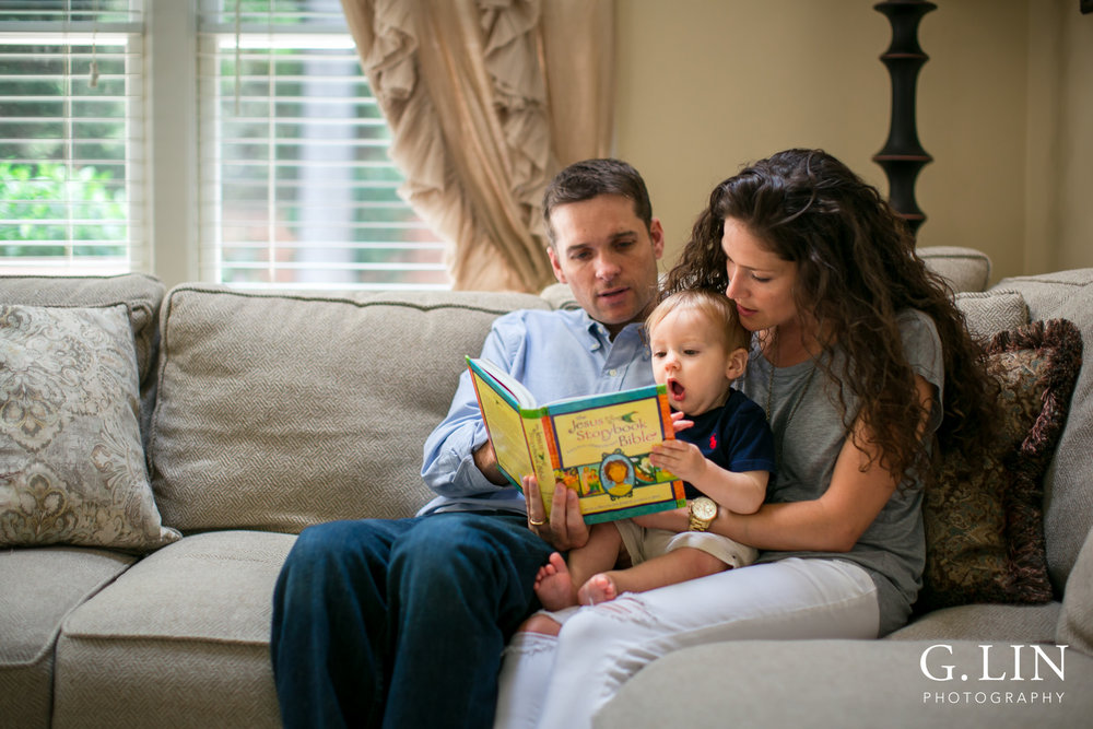 G. Lin Photography | Raleigh Lifestyle Photographer | Family of three reading Jesus storybook bible on couch
