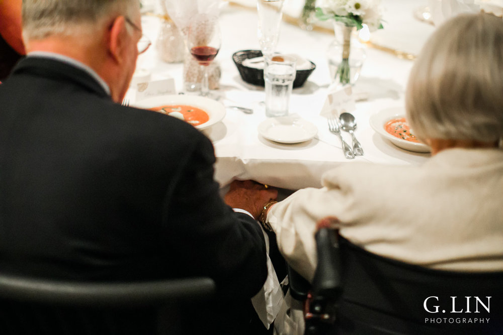 Raleigh Event Photographer | G. Lin Photography | Old couple holding hands during prayer